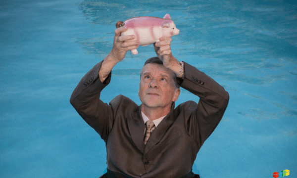 Man holding piggy in water