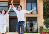 happy young people buy first property